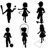 Silhouettes children playing Stock Photography