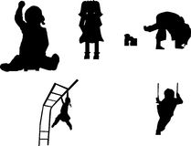 Silhouettes of children playing. Children silhouettes playing in play ground having fun Royalty Free Stock Image