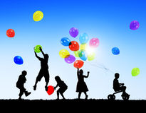 Silhouettes of Children Playing Balloons Royalty Free Stock Image