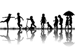 Silhouettes of children playing Stock Photos