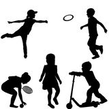 Silhouettes of children playing Royalty Free Stock Photos