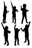 Silhouettes of children Stock Image