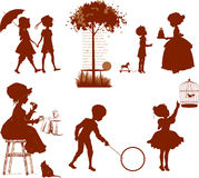 Silhouettes of children Stock Photo