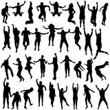 Silhouettes of children and young people jumping Royalty Free Stock Photography
