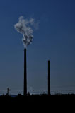 Silhouettes of chimneys with fog Stock Photography