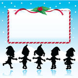 silhouettes christmas kids with signboard Royalty Free Stock Images