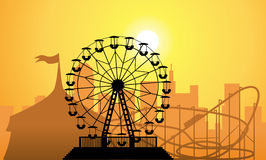 Silhouettes of a city and amusement park