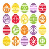 Silhouettes of color Easter eggs isolated on white background. Holiday Easter Eggs decorated with flowers and leafs. Print design,. Label, sticker, scrap royalty free illustration