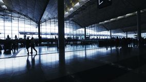 Silhouettes of Communter in Airport. Silhouettes of Travelers in Airport stock video footage
