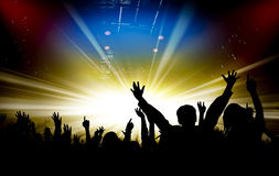 Silhouettes of concert and bright stage lights background Royalty Free Stock Photography