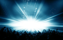Silhouettes of concert and bright stage lights background Royalty Free Stock Images