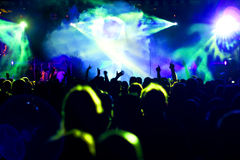Silhouettes of concert crowd. In front of bright stage lights Stock Photography