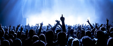 Silhouettes of concert crowd. In front of bright stage lights royalty free stock images