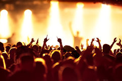 Silhouettes of concert crowd. In front of bright stage lights Royalty Free Stock Image
