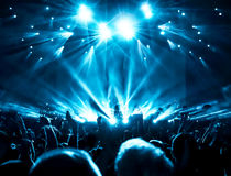 Silhouettes of concert crowd. In front of bright stage lights Royalty Free Stock Photo