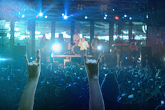The silhouettes of concert crowd in front of bright stage lights. Concert of an abstract rock band Royalty Free Stock Photo