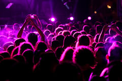 Silhouettes of concert crowd in front of bright stage lights Royalty Free Stock Photos