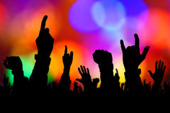 Silhouettes of concert crowd hands supporting band on stage Royalty Free Stock Images