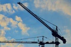 Silhouettes construction cranes Royalty Free Stock Photos