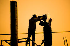 Silhouettes Construction workers Stock Photo