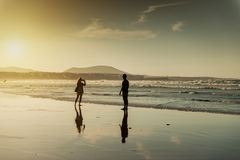 Silhouettes of a couple at beach Stock Photography