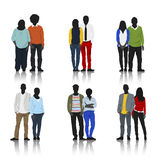 Silhouettes of Couple Casual People in a Row Stock Photo