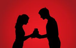 Silhouettes of couple with gift Stock Image