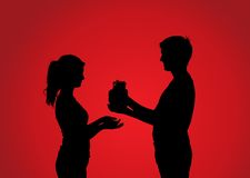 Silhouettes of couple with gift Royalty Free Stock Photography