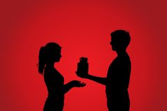 Silhouettes of couple with gift Royalty Free Stock Photos