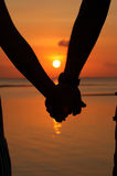 Silhouettes couples hands Stock Photos