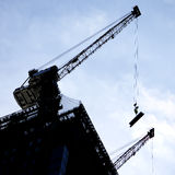 Silhouettes of crane on building Royalty Free Stock Image