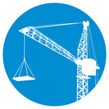 Silhouettes of crane on building Stock Photos