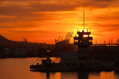 Silhouettes of cranes and buildings in Varna port Stock Image