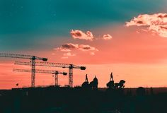 Silhouettes of cranes, statues and buildings Madrid, Spain royalty free stock photo