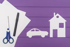 The silhouettes cut out of paper of car and house Stock Photography