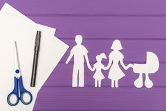The silhouettes cut out of paper of man and woman with child and pram Stock Images