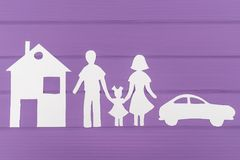 The silhouettes cut out of paper of man and woman with one girl near the house and car Royalty Free Stock Photo