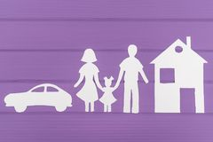 The silhouettes cut out of paper of man and woman with one girl near the house and car Royalty Free Stock Photos