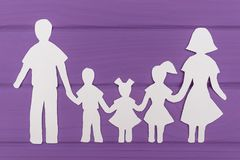 The silhouettes cut out of paper of man and woman with two girls and boy Royalty Free Stock Photo