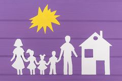 The silhouettes cut out of paper of man and woman with two girls and boy under the sun, house near Royalty Free Stock Photography