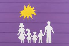 The silhouettes cut out of paper of man and woman with two girls and boy under the sun royalty free stock photos