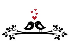 Silhouettes cute birds kiss and red hearts Stock Image