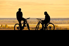 Silhouettes of cyclists Stock Photo
