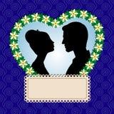 Silhouettes d'amants de whith de carte Images stock