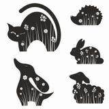 Silhouettes d'animaux avec des fleurs Photo stock