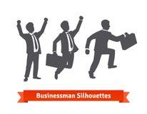Silhouettes d'homme d'affaires Heureux et intensifiant Photographie stock libre de droits