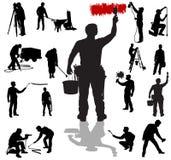 Silhouettes d'ouvriers Photographie stock libre de droits