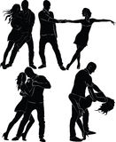 Silhouettes of dancing couples. Royalty Free Stock Photos