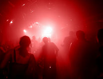 Silhouettes of dancing people. In a disco Stock Photo