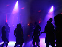 Silhouettes of dancing people. In a disco Stock Image